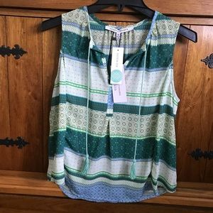 Green and blue sleeveless blouse